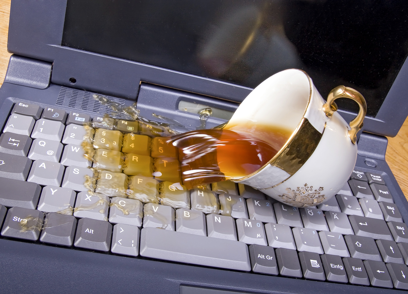 Save Your Laptop After a Spill - Good Times